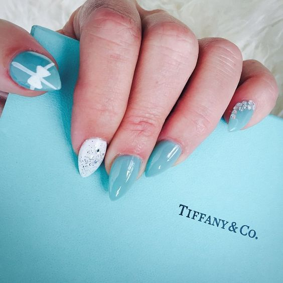 Trying something new #nailswag #nailart #stilletonails #tiffanyblue #tiffanys #sf #sanfrancisco #shiny #luxury #luxuryliving #tiffanyinspired