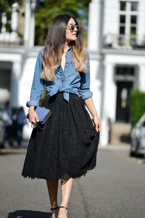 Anisa Sojka styles denim Ted Baker shirt in a knot at the waist with black lace ballerina skirt | Blue hardcover clutch bag with crystal and gold detail | Floral printed sandal heels | White Triwa nicki sunglasses | Ombre wavy hair style | Fashion blogger street style shot in London by David Nyanzi