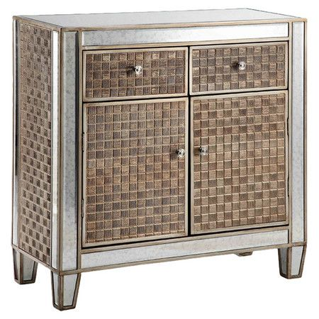 Display a vase of bright blooms in the parlor or stow board games and media accessories in the den with this glamorous cabinet, showcasing mirrored inlay and...