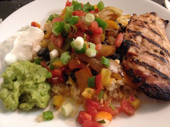 Delicious and healthy. Grilled chicken with quinoa, black beans, shredded cheddar, peppers and onions, pico de gallo, scallions, guac, and Greek yogurt.  Can easily make this ahead of time.