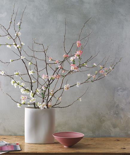 Bouquet Of Branches: Less is more when it comes to woody stems, like quince, cherry, and dogwood. Select just three or four sculptural specimens, and use a heavy oblong vase that's about a third as tall as the branches. Aim for an asymmetrical spray so the branches reach rather than lean.: