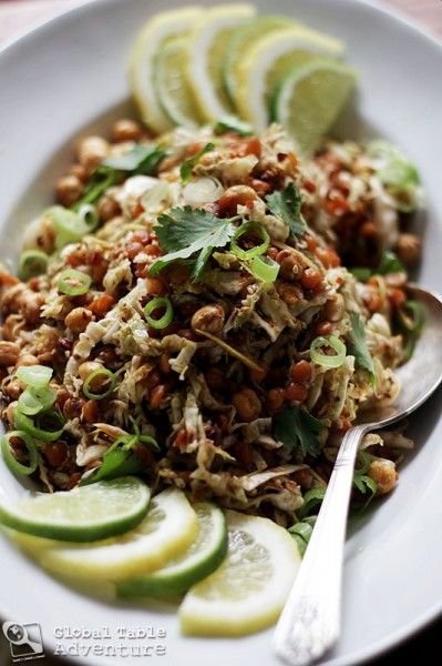 Ingredients:  1 thumb ginger,in tiny matchsticks  1/4 cup lemon or lime juice  3 cups finely shredded cabbage    For frying:   1/2 cup dried chickpeas, soaked overnight in water  1/2 cup dried lentils, soaked overnight in water  3 cloves garlic, slivered  1/4 cup sesame seeds  1/3 cup peanut oil    Dressing:     Fish sauce    Garnish:    cilantro, torn  crushed peanuts  green onion, sliced  Lime slices  Lemon slices  Red pepper flakes