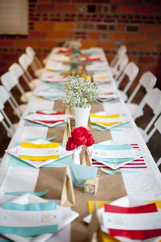 "happy + fresh color scheme: kraft paper runner and brown paper sacks, white plates with colored napkins + scrapbook paper ""placemats"""
