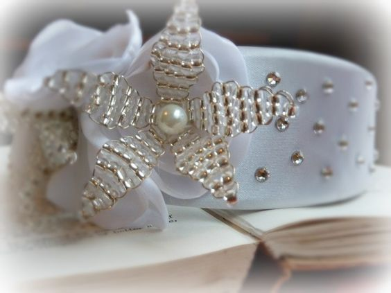 Handmade satin, seedbead and swarovski headband. White satin wide band covered with swarovski crystals, handmade satin flowers and individual glass beaded blooms with a pearl centre.