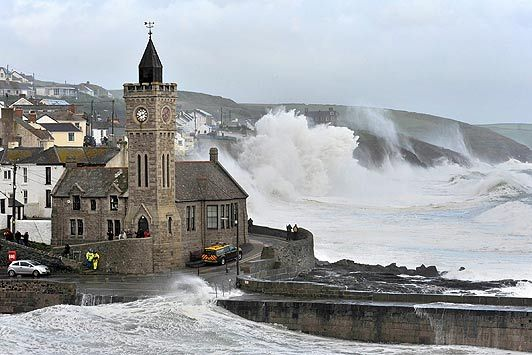 Waves crash on the harbour at Porthleven, Cornwall