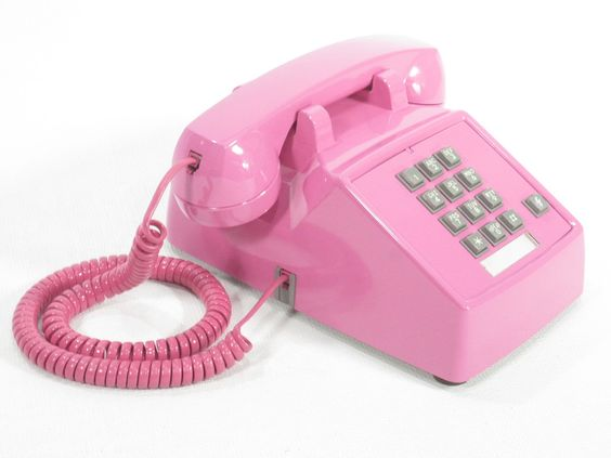 Vintage telephone Candy Pink push button phone, via Etsy.