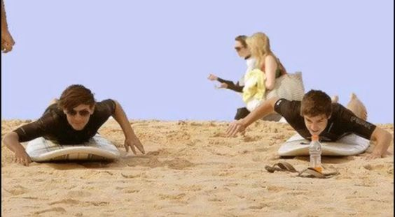 Louis and Liam learning how to surf.