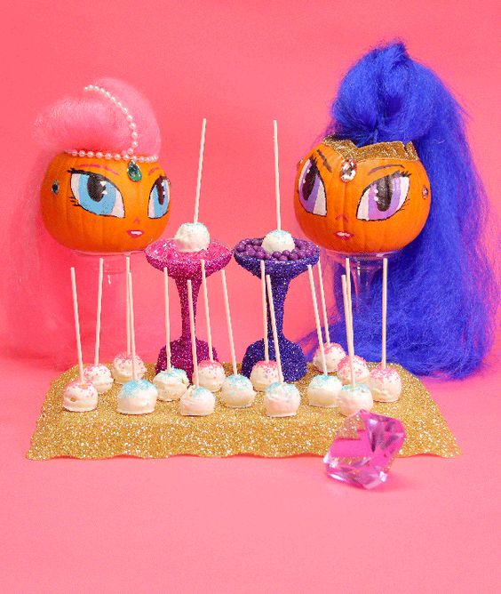 Trick or treat with Shimmer and Shine and some pink and teal sparkle cake pops!