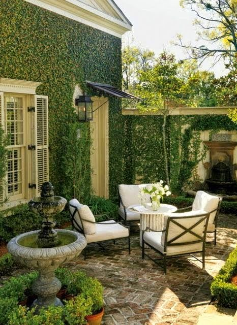 Outdoor Areas: Fountain for noise of neighbor coverage with ivy: