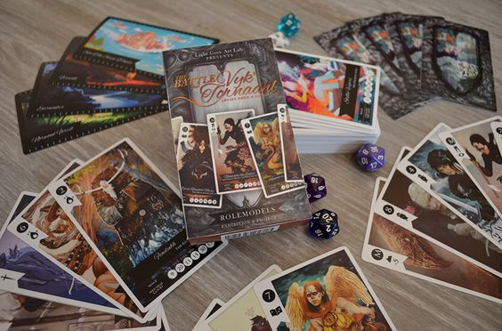 ROLEMODELS: The Battle for Vyk' Tornaahl Exhibition and Card Game. I had the pleasure of co-curating this Fantasy RPG self-portrait show at Light Grey Art Lab as well as designed the packaging and all of the corresponding material for the card...