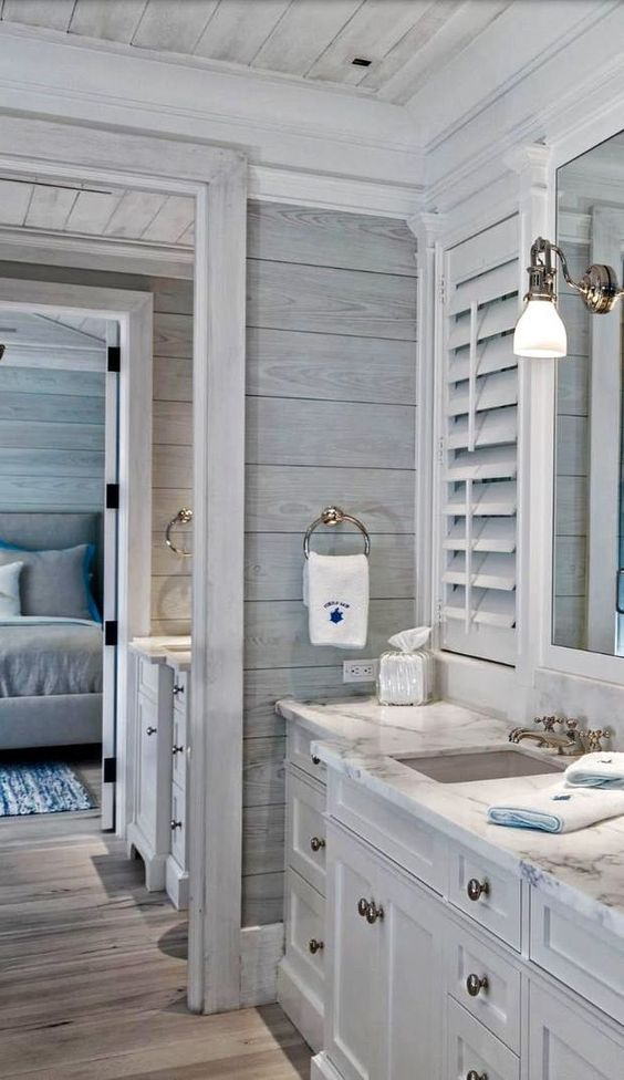No idea who's stunning work this is but it is absolutely gorgeous. Love the grey wood shiplap walls. The white shutters, the beautiful detailed vanity.: