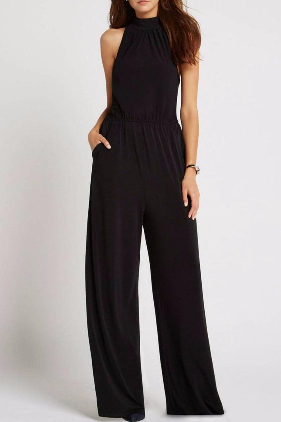 Jumpsuit features a mock neckline with button closures keyhole cutout at back and front slash pockets. Can be worn with flats for an easy day time look or heels for a sophisticated evening look.   Back Slit Jumpsuit by BCBGeneration. Clothing - Jumpsuits & Rompers Statesboro Georgia