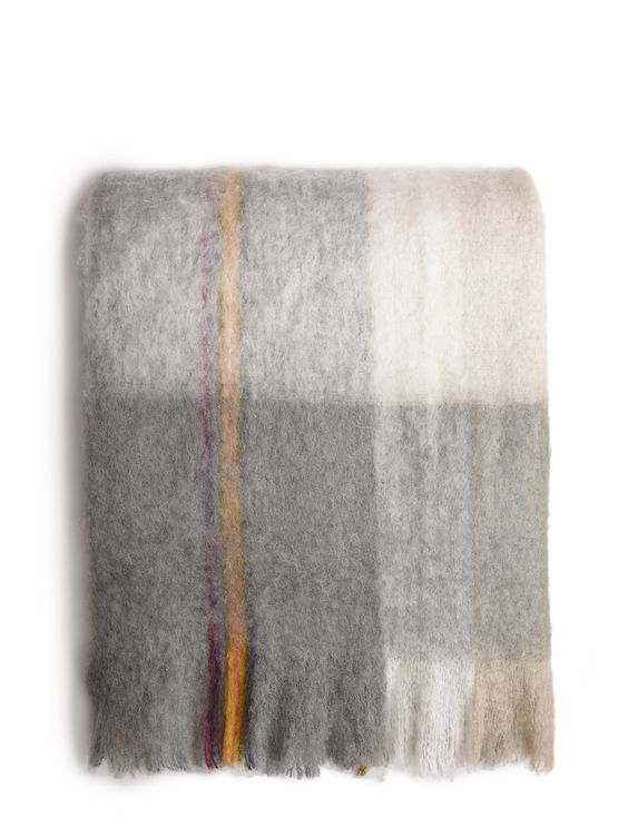 A brushed wool plaid throw with subtle multicolor detailing reflects Ellen's signature style.