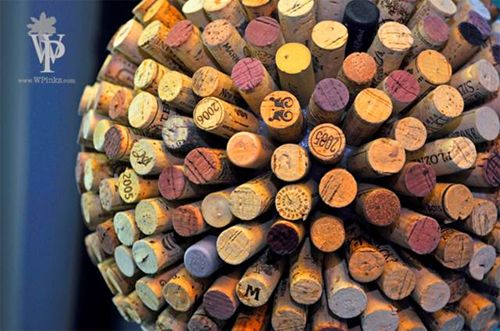 DIY Wine Cork Hanging Ball. http://www.snooth.com/articles/diy-wine-cork-and-bottle-crafts/