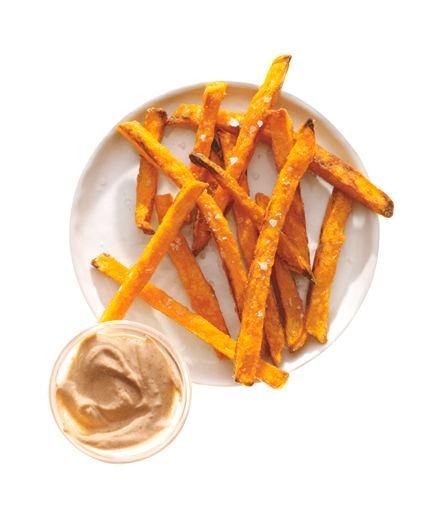 Cook frozen sweet potato fries according to the package directions. Mix together 2 tablespoons plain low-fat yogurt and ½ teaspoon chipotles in adobo sauce and serve for dipping.