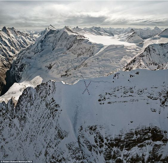 X marks the spot: Climbers perch precariouslyon the North Face of the Eiger in 2011...