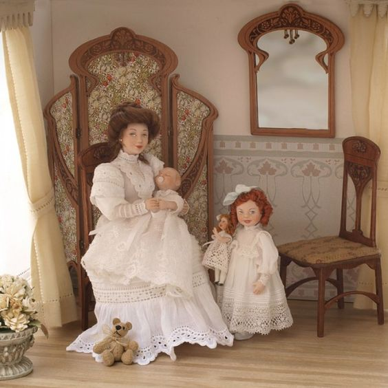 porcelain mother,baby,girl and doll wearing antique (1900) lace dress.