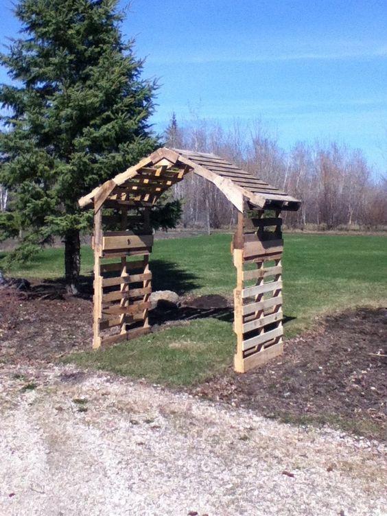 DIY pallet arch could paint and plant around it outdoor for prop -- or maybe put a bench in it?  or swing?  Looks like it is made from five pallets.: