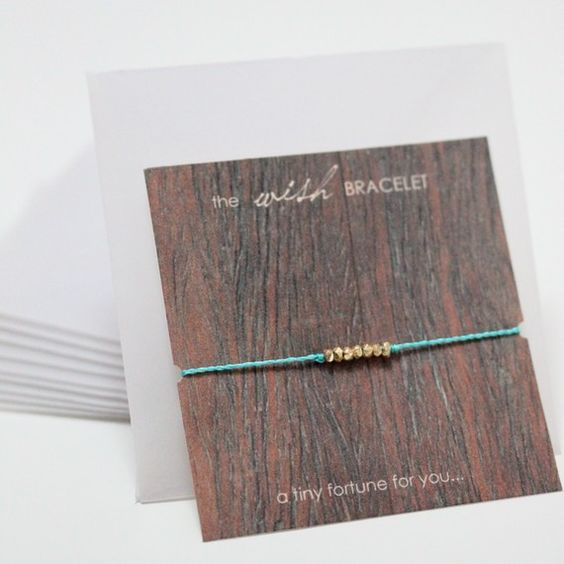 wish bracelet.  when it falls off, your wish comes true.  tie closure w/ one bead on each tie end.