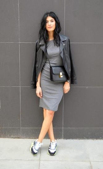 Skirts & Sneakers Trend: charcoal gray knit dress worn with a leather jacket and gray running sneakers: