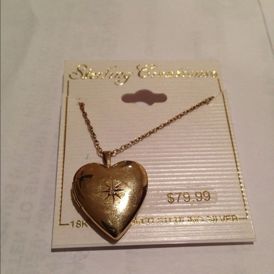 Cute neckless & heart 18k over sterling silver Very beautiful necklace with a super cute heart in 18 KT gold over sterling silver that open to put 2 pictures it's retail for 79.99 plus taxes it's very super gift Accessories