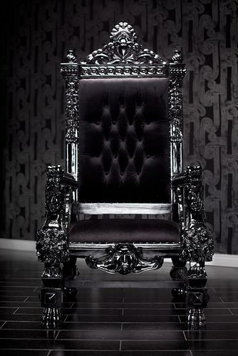 4061 BLACK LACQUER BAROQUE THRONE CHAIR  Be the king or queen or your house in this magnificent throne chair. Reminiscent of the thrones royalty used to sit in during the Baroque period and hand-carved out of the highest quality imported wood, this large chair exudes grandeur and sophistication. Upholstered in the finest black velvet and finished with beautiful chrome studs, this chair is the perfect rock star addition to any home.  It can be customized as you please!: