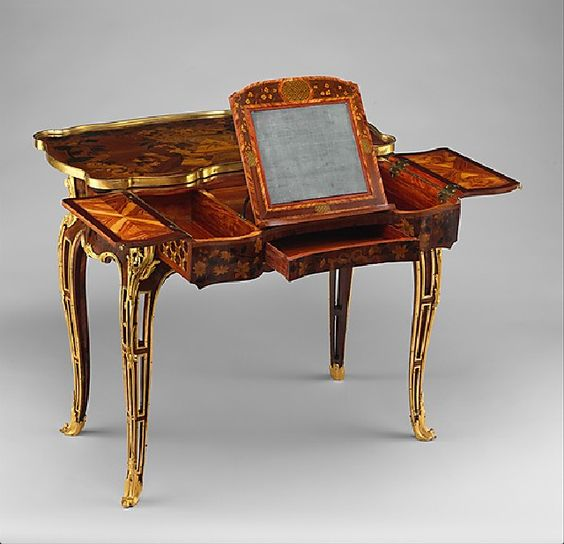 Lovely mechanical table which had belonged to Madame de Pompadour, a mistress to Louis XV before Du Barry.    ca.1761-1763 by Roger Vandercruse: