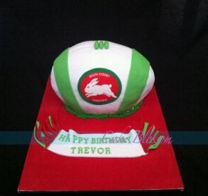 Sydney Rabbitohs rugby ball birthday cake.