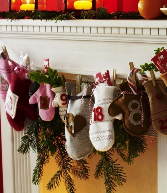 Felt Christmas Mantel Advent Calendar, 2013 Christmas Felt Ornaments #2013 #felt #christmas #decorations www.loveitsomuch.com