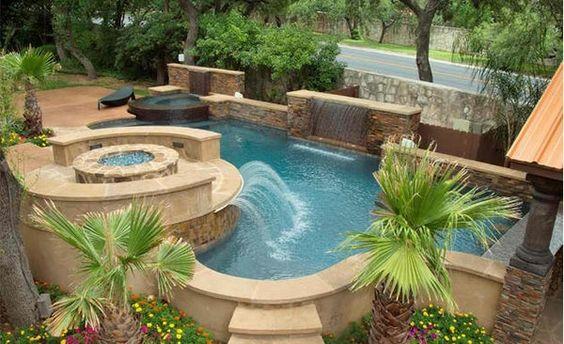 gartengestaltung garten pool und feuerstelle luxuriös palmen - eine feuerstelle am pool