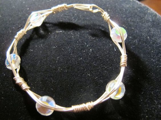 Silver wire bangle bracelet with round clear by Naomirabinowitz, $10.00