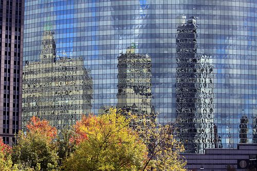 "Reflections in 333 West Wacker Drive, Chicago, IL. Architecture firm: Kohn Pedersen Fox.  333 Wacker Drive has been featured prominently in a handful of movies, including ""The Truman Show,"" ""Ferris Bueller's Day Off,"" and ""Batman Begins."""