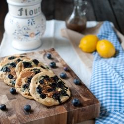 Whole wheat pancakes filled with bursting blueberries and hints of lemon. Quick, easy, and healthy!