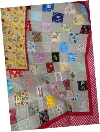 I Spy quilt with a taupe background.