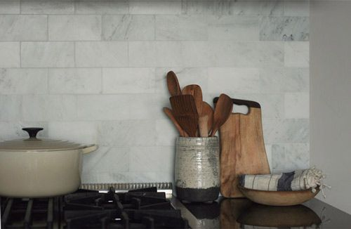 love this soft, cool marble backsplash. & lots of wood and ceramic.