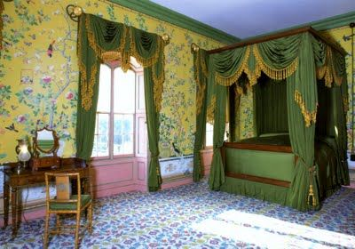 yellow Chinese wallpaper in Queen Victoria's bedroom. Royal Pavilion Brighton.