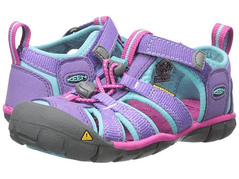 Keen: Kids Seacamp II CNX Toddler/Little Kid (Purple Heart/Very Berry) The Kid's Seacamp II CNX water shoe is is a low profile Keen sandal for kids. This airy, lightweight sandal is an all-around adventurer. Integrated, contoured arch and metatarsal ridge provide underfoot support while the toggle lacing system gives it a secure fit. They offer superior drainage and are easy to adjust in or out of the water. The washable upper makes cleaning easy