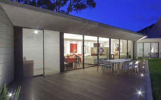 Diseño de terraza con pisos de madera #fachadasmodernasunpiso