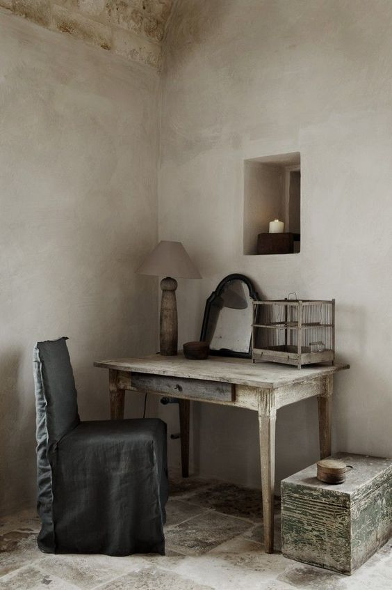 Quiet and rustic desk area of European farmhouse with Old World style. European Farmhouse and French Country Decorating Style Photos. #rusticdecor #europeanfarmhouse