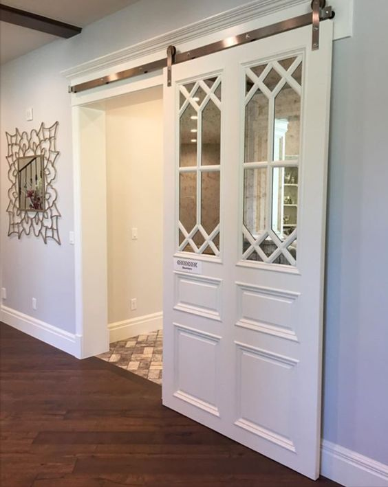 White Sliding Barn Door With Antiqued Mirror And Decorative Mullion Insert Pantry Design Interior Barn Doors Home Remodeling