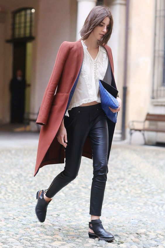 Leather pants and a lacy top add up to a perfect Fashion Week look.  Milan Fashion Week Fall 2014 Street Style