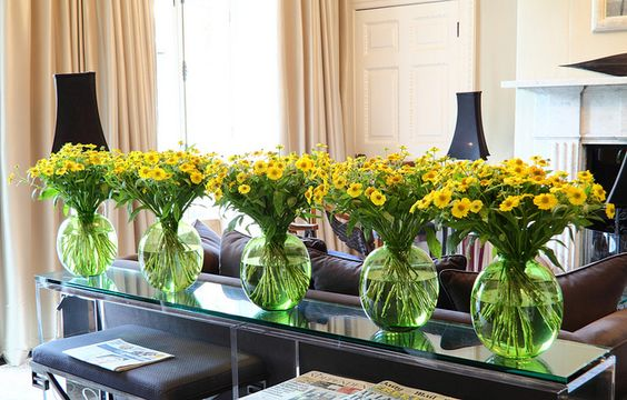 Occasionally I like to use really bright colours in this room, rather than trying to harmonise or tone in. This variety of Helenium, 'Kanaria', is very inexpensive and also a long-laster. These are the vases just before I was about to take them away. They look their best after a week by Ken Marten