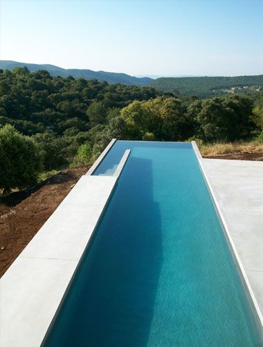 Studio ko lap pool with infinity edge swimming pool for Pool edges design