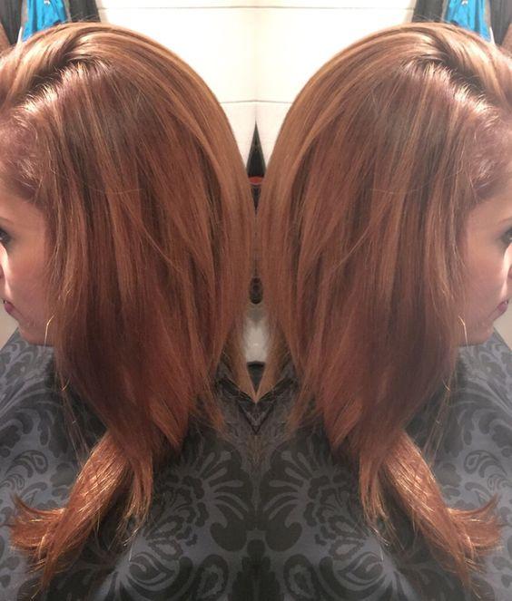 a nice light auburn brown with soft highlights hair by