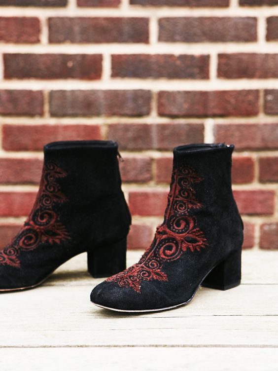 Estella Heel Boot   Classic suede ankle boots featuring a chic shape with a rounded toe and block heel. Contrast boho-inspired embroidery detailing. Exposed back zip for an easy on-off.