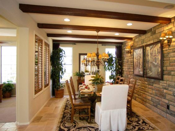 Warm And Cozy Dining Room Moodboard: Stone Facade Walls And Exposed Wood Ceiling Beams Encase This Cozy Dining Space. Plantation