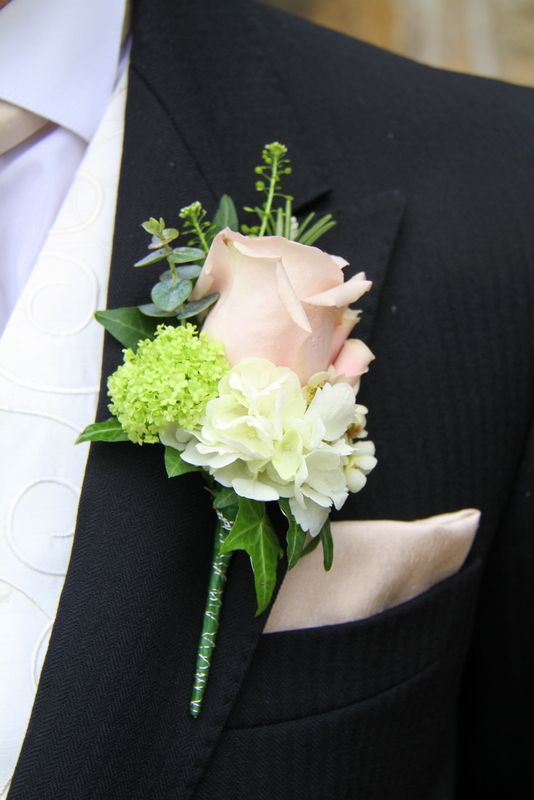 Grooms button hole with foliage