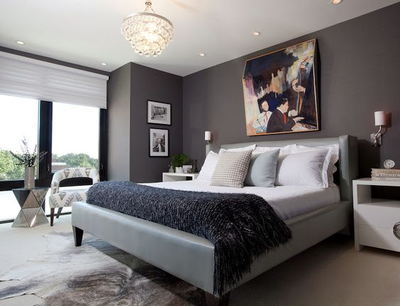 Sleek and modern grey master bedroom with a leather platform bed - modern schlafzimmer
