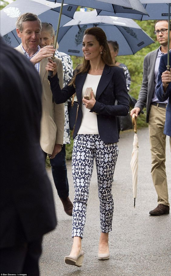 Kate, 34, wore a pair of patterned skinny trousers, which she teamed with the same Monsoon wedges she wore yesterday as she arrived at the Eden Project in Cornwall: