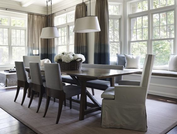 Blue and gray dining room with built-in window seat and ...